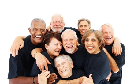 A group of senior mature people standing together over white background